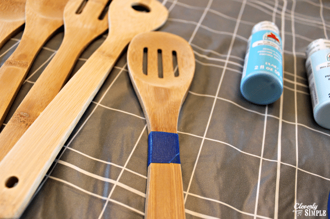 using painters tape to make dipped kitchen utensils