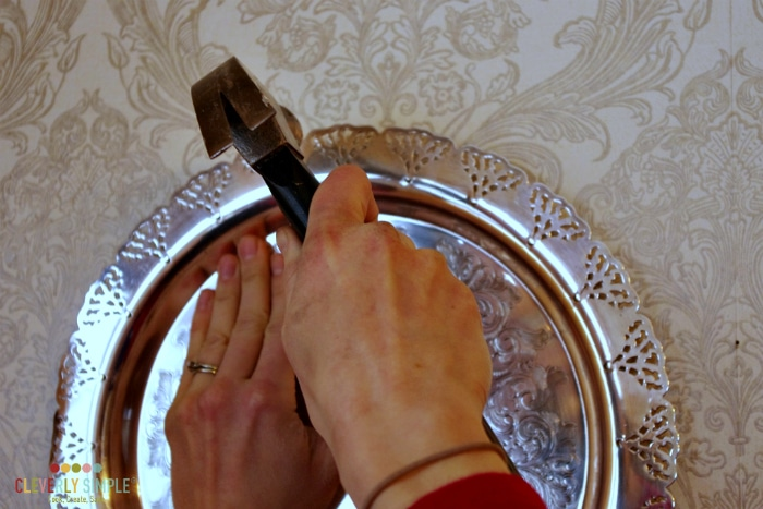 Hanging silver plates as a simple DIY wall idea