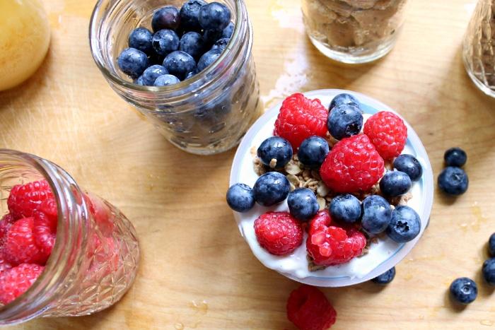 strawberries and blueberries on yogurt