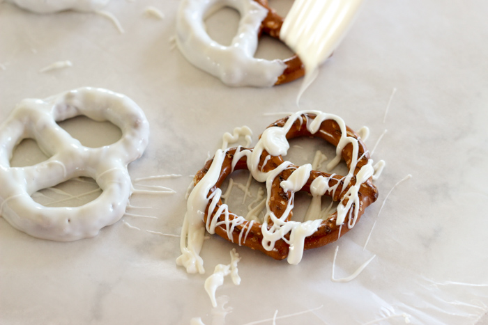 swirling chocolate onto pretzels