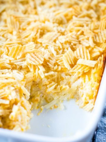 slice out of cheesy hashbrown casserole in pan