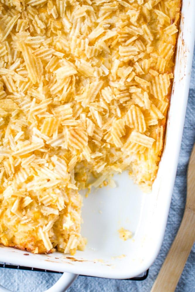 cheesy hashbrown casserole in a 9x13 baking dish