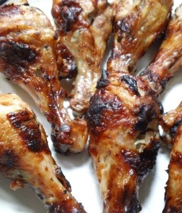 grilled drumsticks on plate
