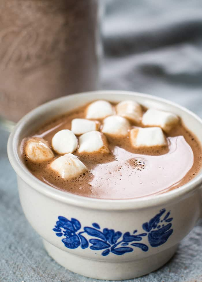 hot chocolate in mug with marshmallow with homemade mix in mason jar