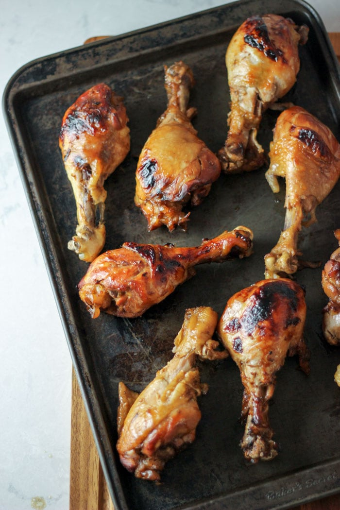 Drumsticks on dark sheet pan