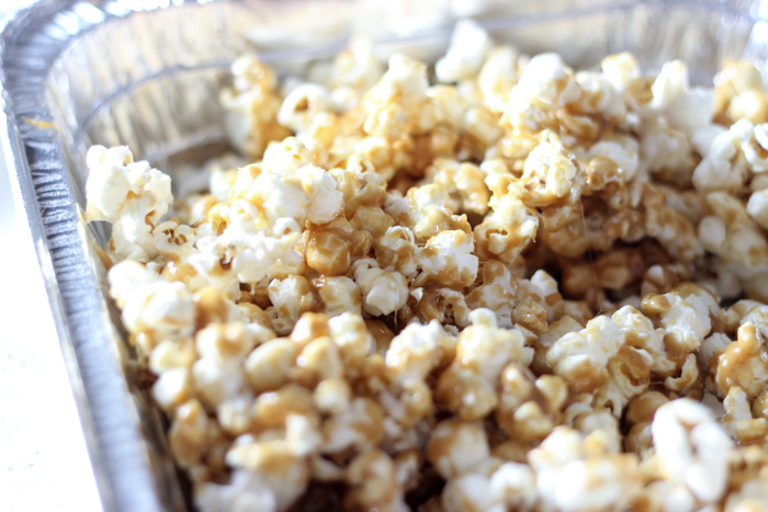 metal pan filled with popcorn and caramel
