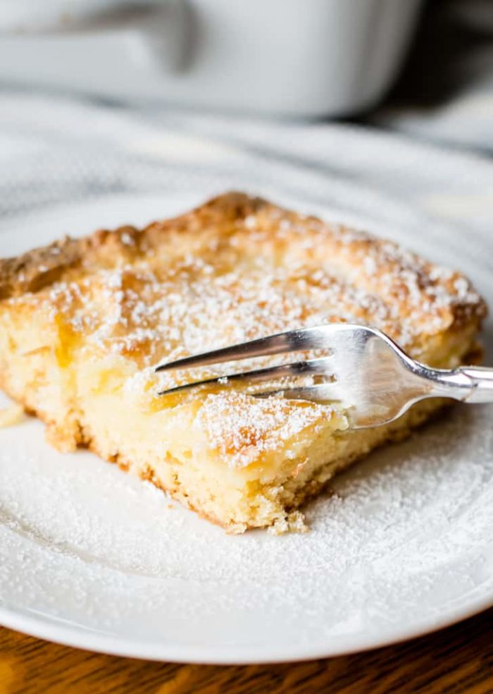 gooey butter cake on plate with fork