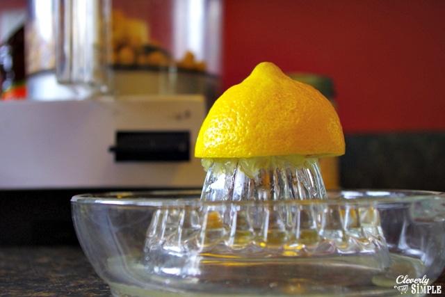 juicing a lemon to make homemade hummus