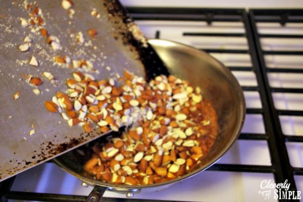Adding almonds to melted sugar to make candied nuts