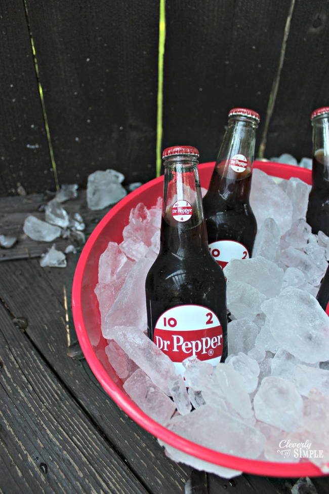 Display Dr Pepper bottles at a backyard party