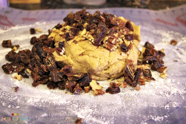 Adding the nuts to the scones