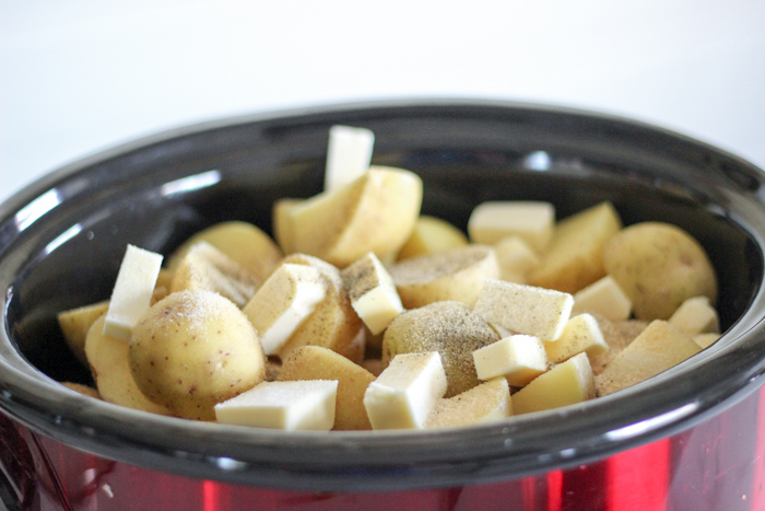 potatoes in crockpot with butter and pepper