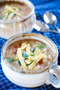 slow cooker beans and rice in bowl with tortilla strips
