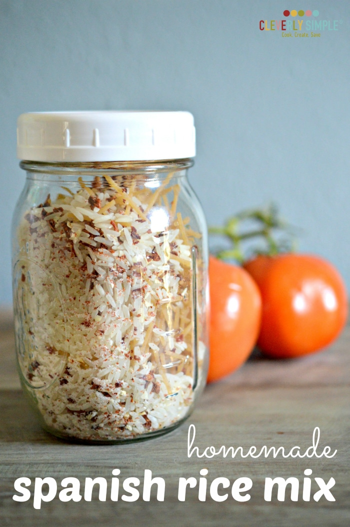 spanish rice mix in a jar with tomatoes in the background