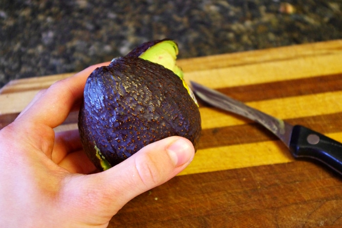 cutting open an avocado