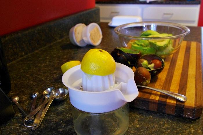 squeezing lemon for guacamole