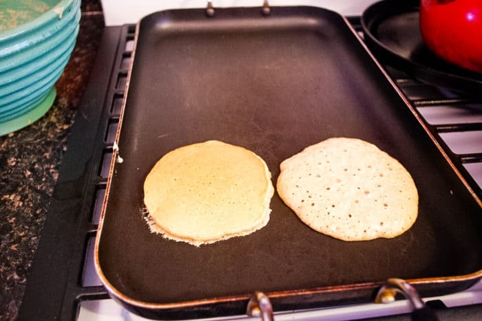 oatmeal pancakes on griddle