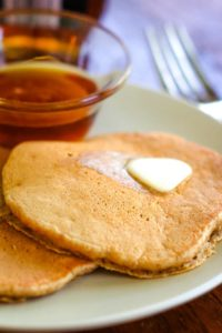 healthy oatmeal pancakes on plate with butter