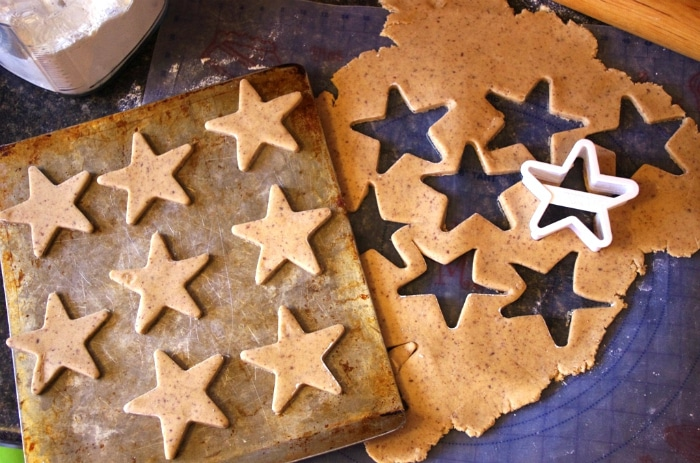 cut out cookie dough with star cookie cutter