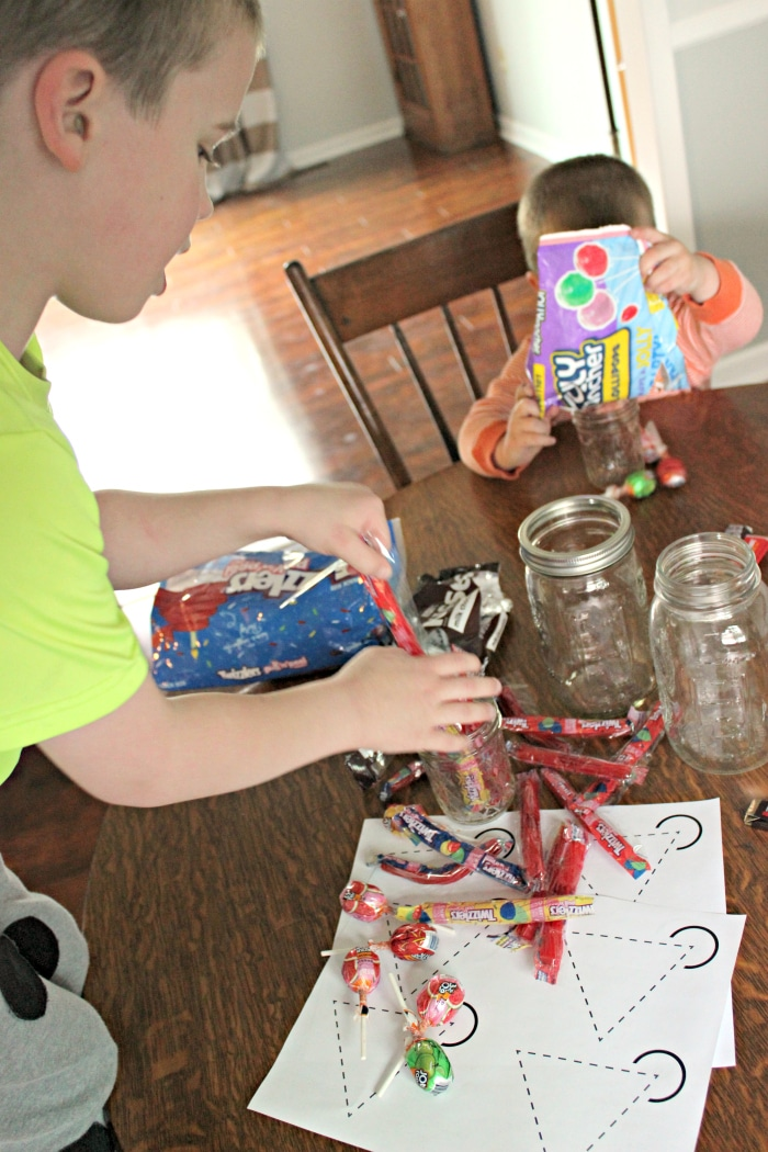 Making a centerpiece for birthday party with candy