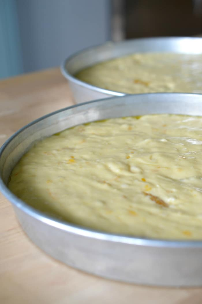 pans of batter ready to be baked