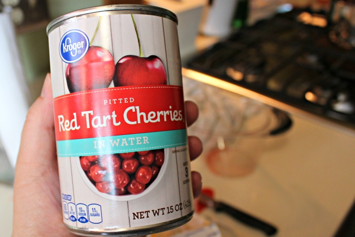 red tart cherries in can in water