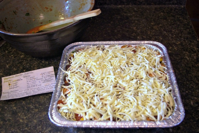 mexican casserole topped with cheese ready for the freezer or to bake