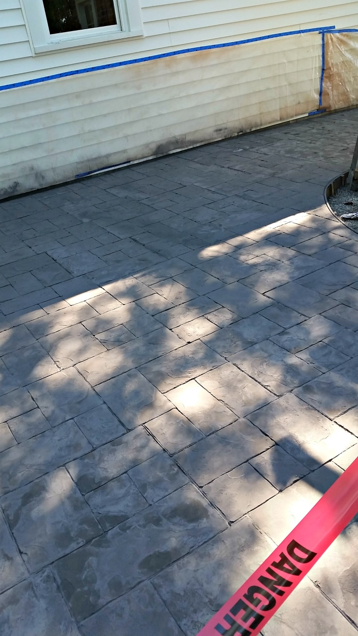 farmhouse-renovation-week-9-back-patio-stamped-concrete-charcoal-color