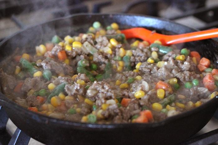 hamburger shepherd's pie cooking in pan