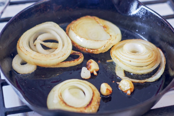 onions sautéing on a cast iron skillet