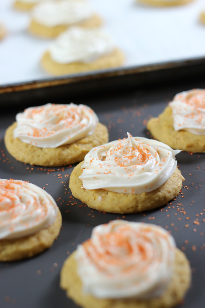 pumpkin cookies with sprinkles and baking pan