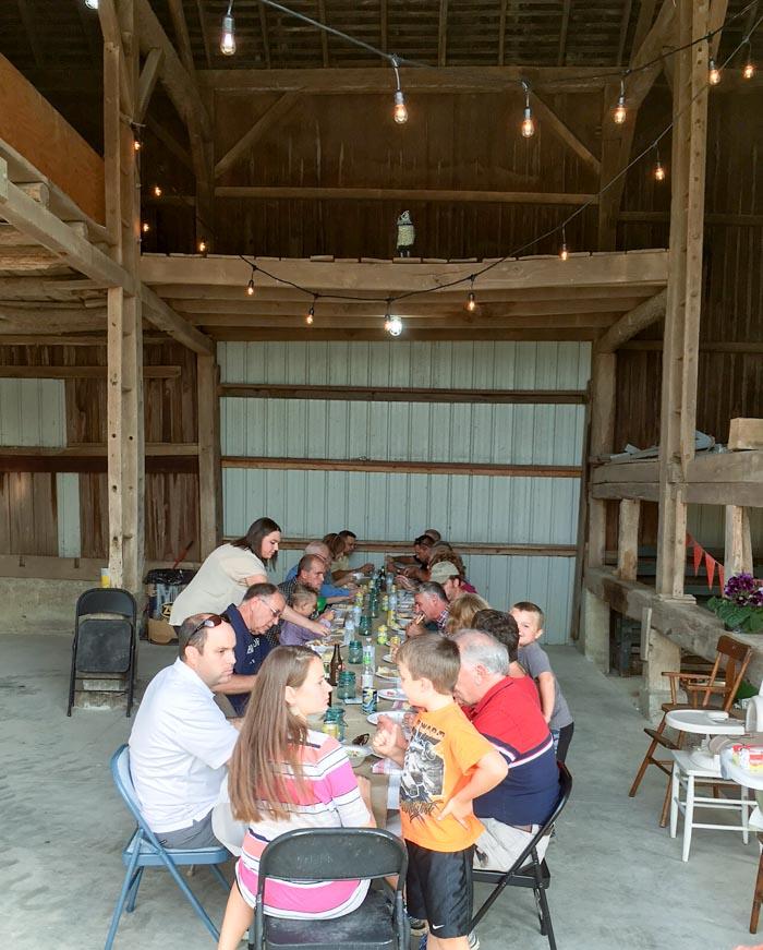long table with neighbors enjoying dinner