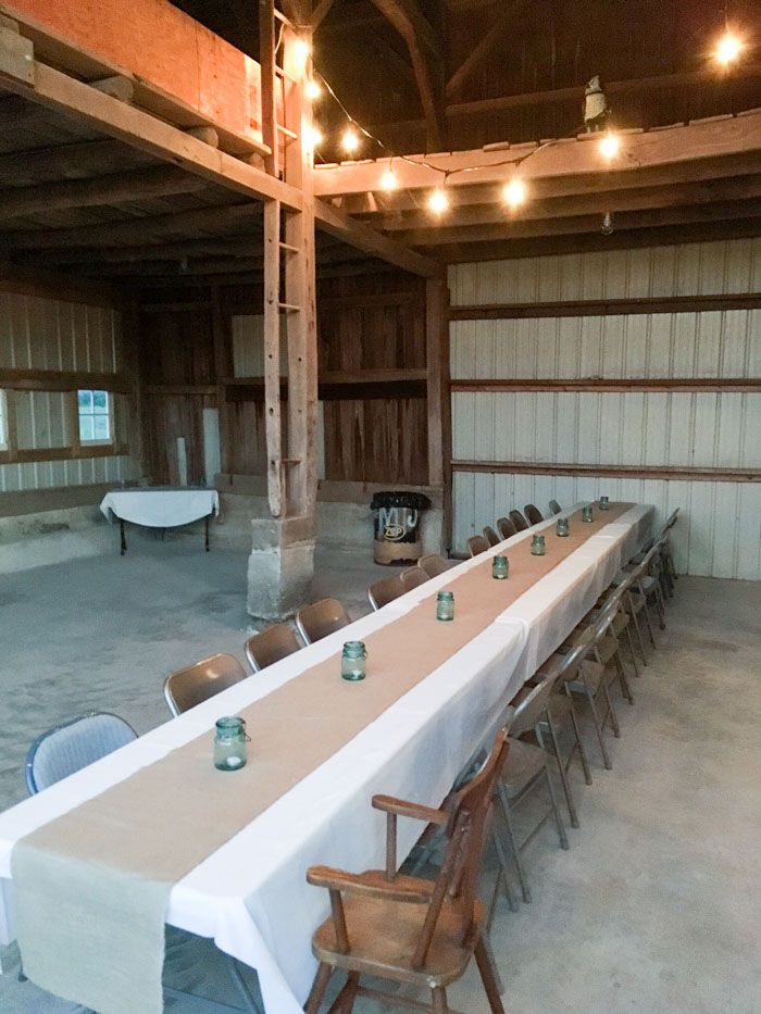 long table in barn with lights for party