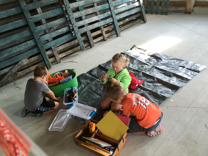 kids playing in barn