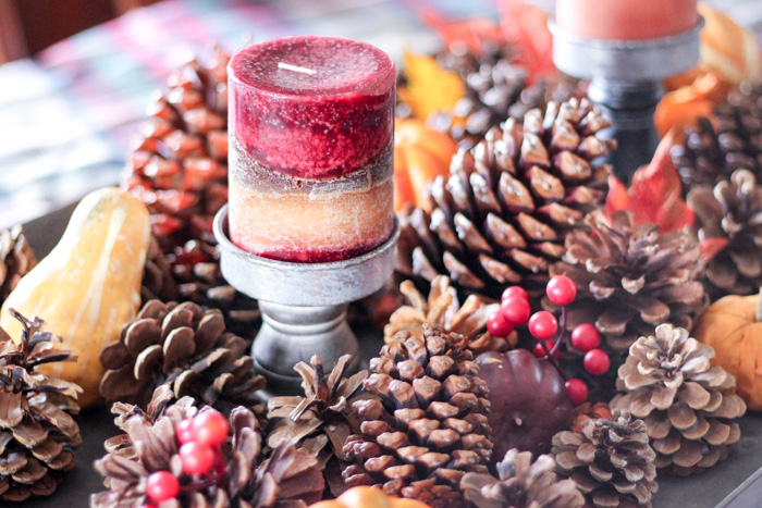 tabletop fall decorations with pinecones, berries and rustic candles