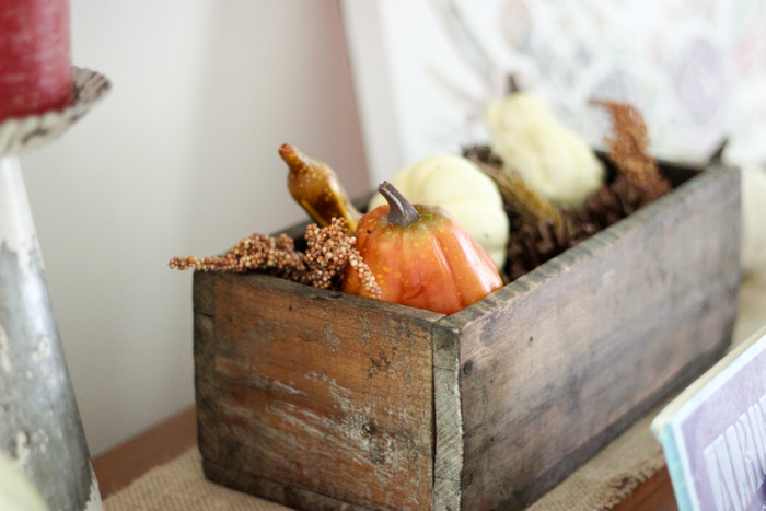 antique fall basket with pumpkins and gords