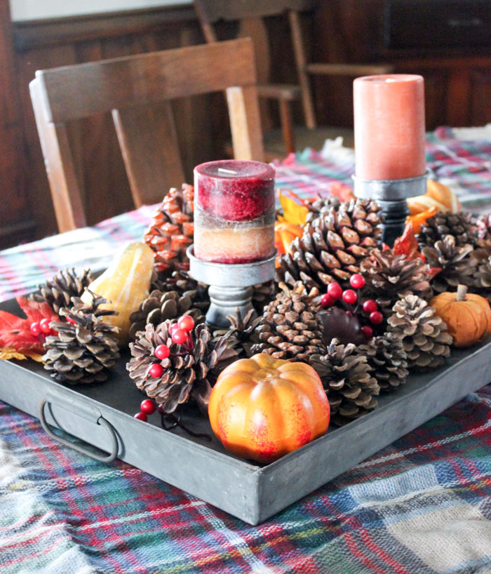 fall tabletop decor with pinecones , leaves and candles