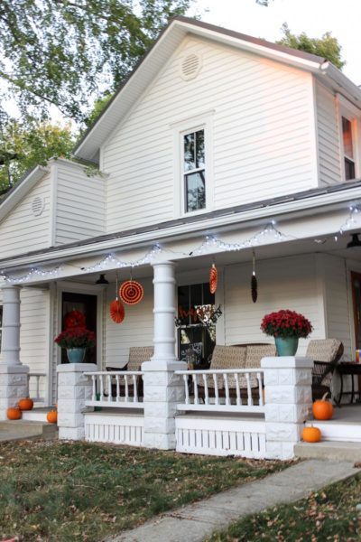 white farmhouse porch with halloween fall decorations