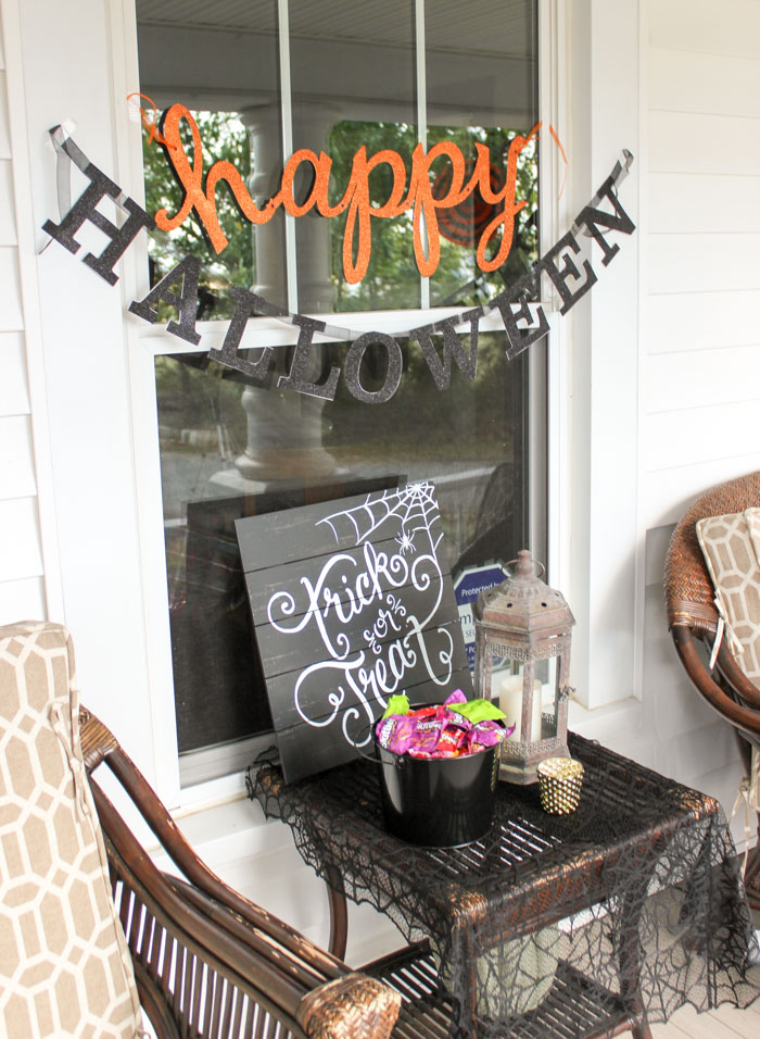 halloween decorations with candy and lantern