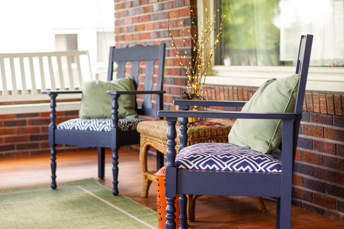 two blue chairs on brick house porch