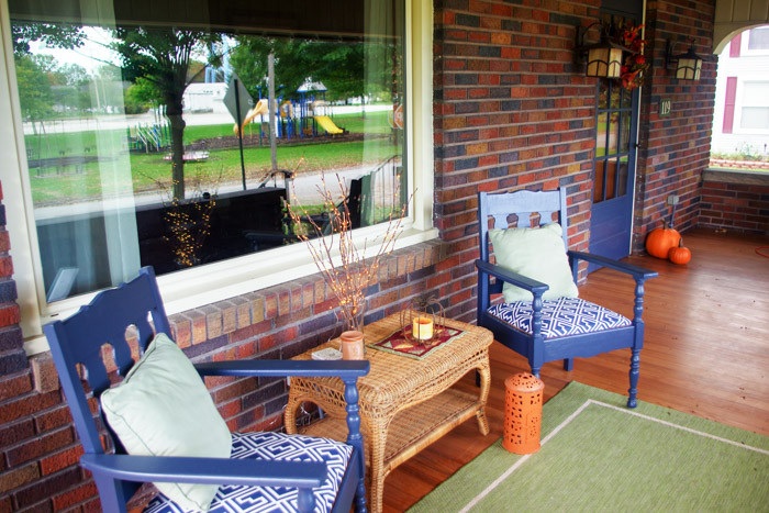 two chairs painted blue on brick house front porch