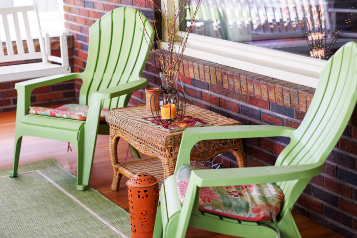 green plastic chairs on front porch
