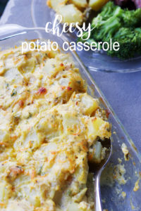cheesy potato casserole with sliced potatoes and side dish