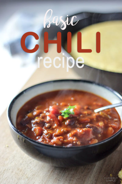 bowl of chili with corn bread in the background
