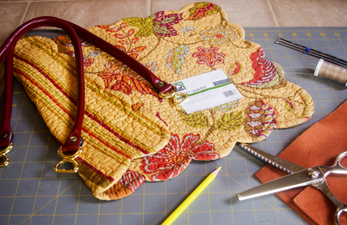 supplies needed to make placemat purse pattern including scissors and shoulder strap