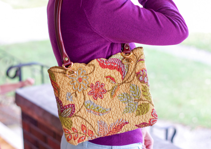 woman wearing placemat purse
