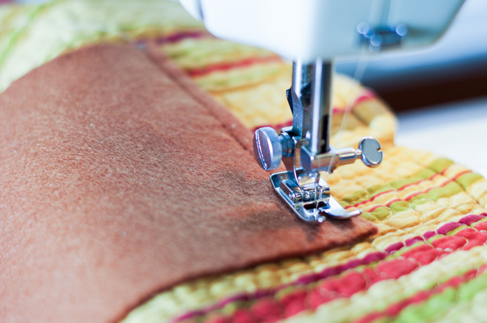 sewing machine foot on placemat