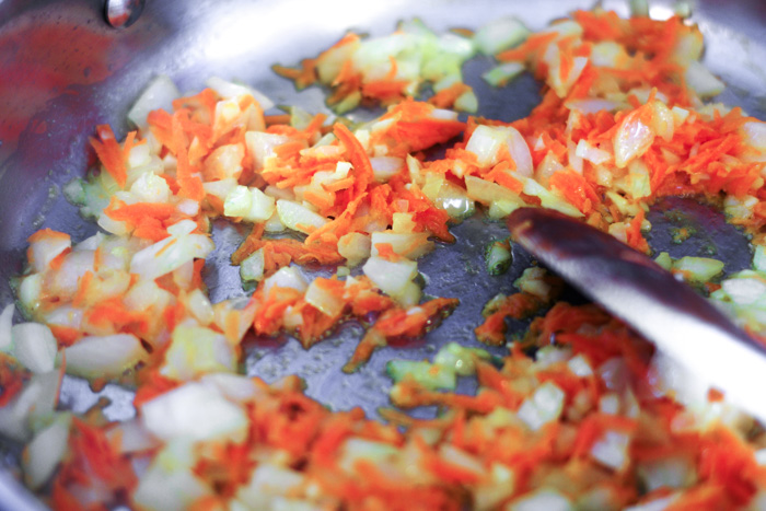 carrots, onion and garlic in saute pan with butter