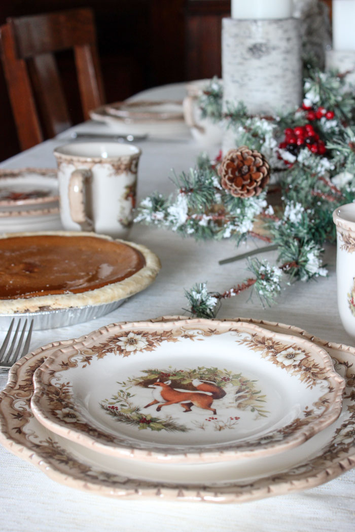 Cracker Barrel woodland plate with Christmas centerpiece and pumpkin pie