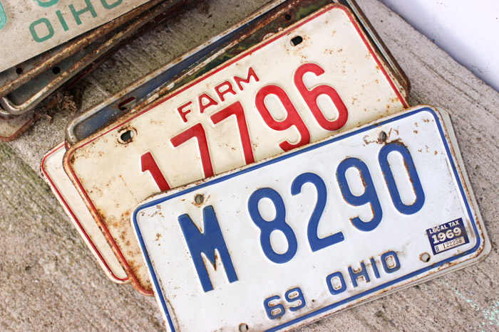 stack of old license plates farm and ohio